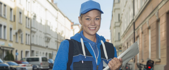 Portrait of a female postal worker with mail